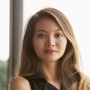 Confident young Asian businesswoman, waist up, close up