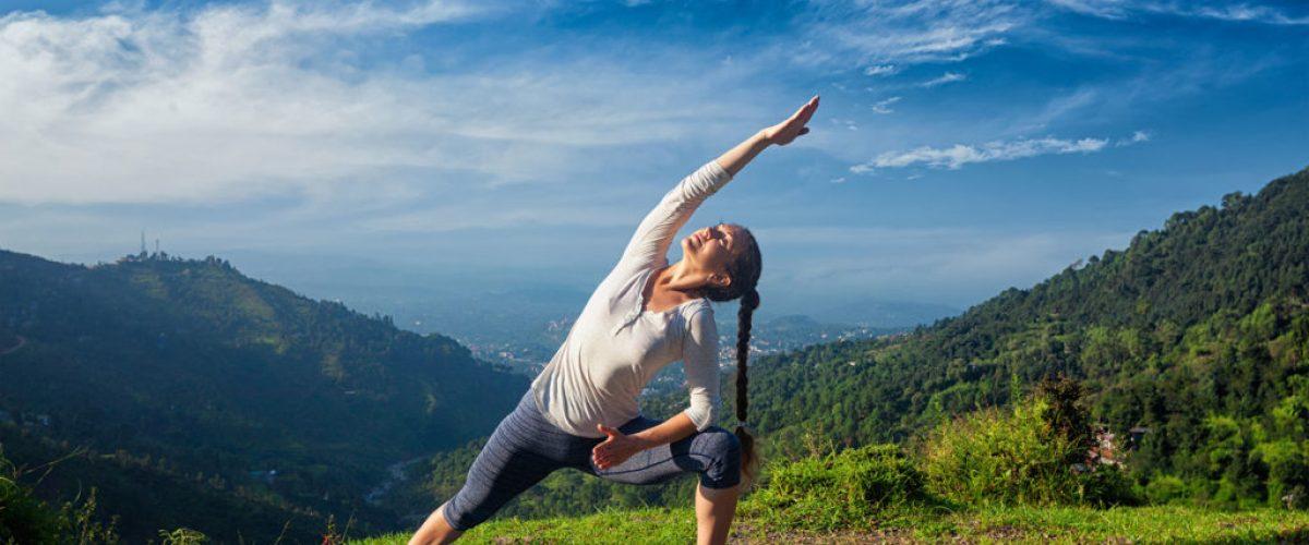 woman-practices-yoga-mountain